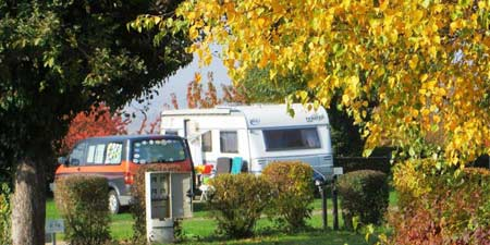 Picturesque Storybook Caravan-Camping in autumn