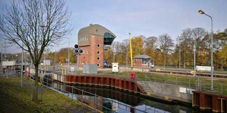 To the big Weir at the Weser river and huge barges lock