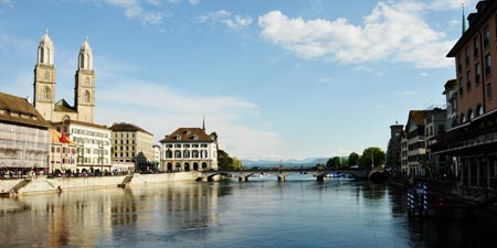 Walk along the Limmat river through downtown Zurich