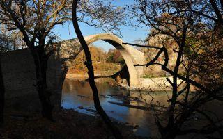 The Konitsa arch bridge crossing the river Aoos