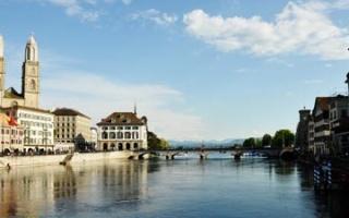 Walk along the Limmat river through downtown Zurich